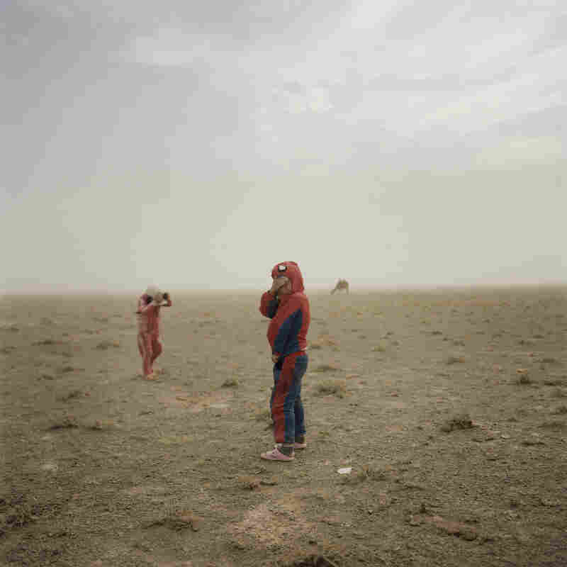 Hovorerden plays with his sister during a sandstorm. Mongolia, Gobi, Omongovi, 2012.