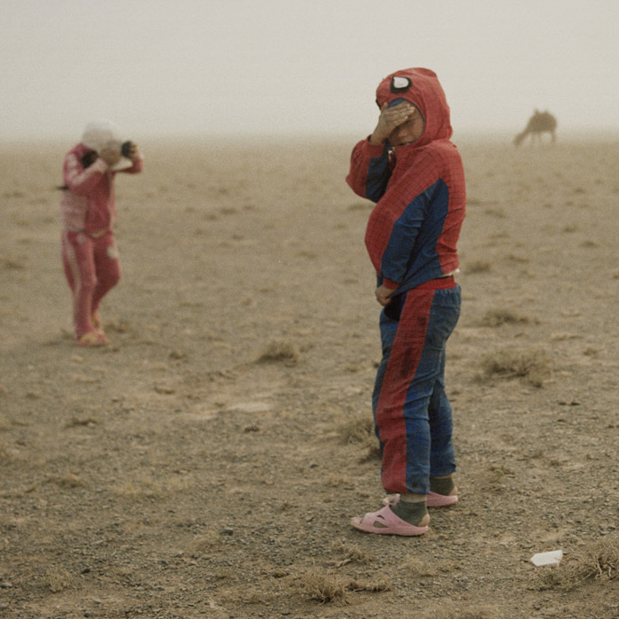 Hovorerden plays with his sister during a sand storm. Mongolia, Gobi, Omongovi, 2012.