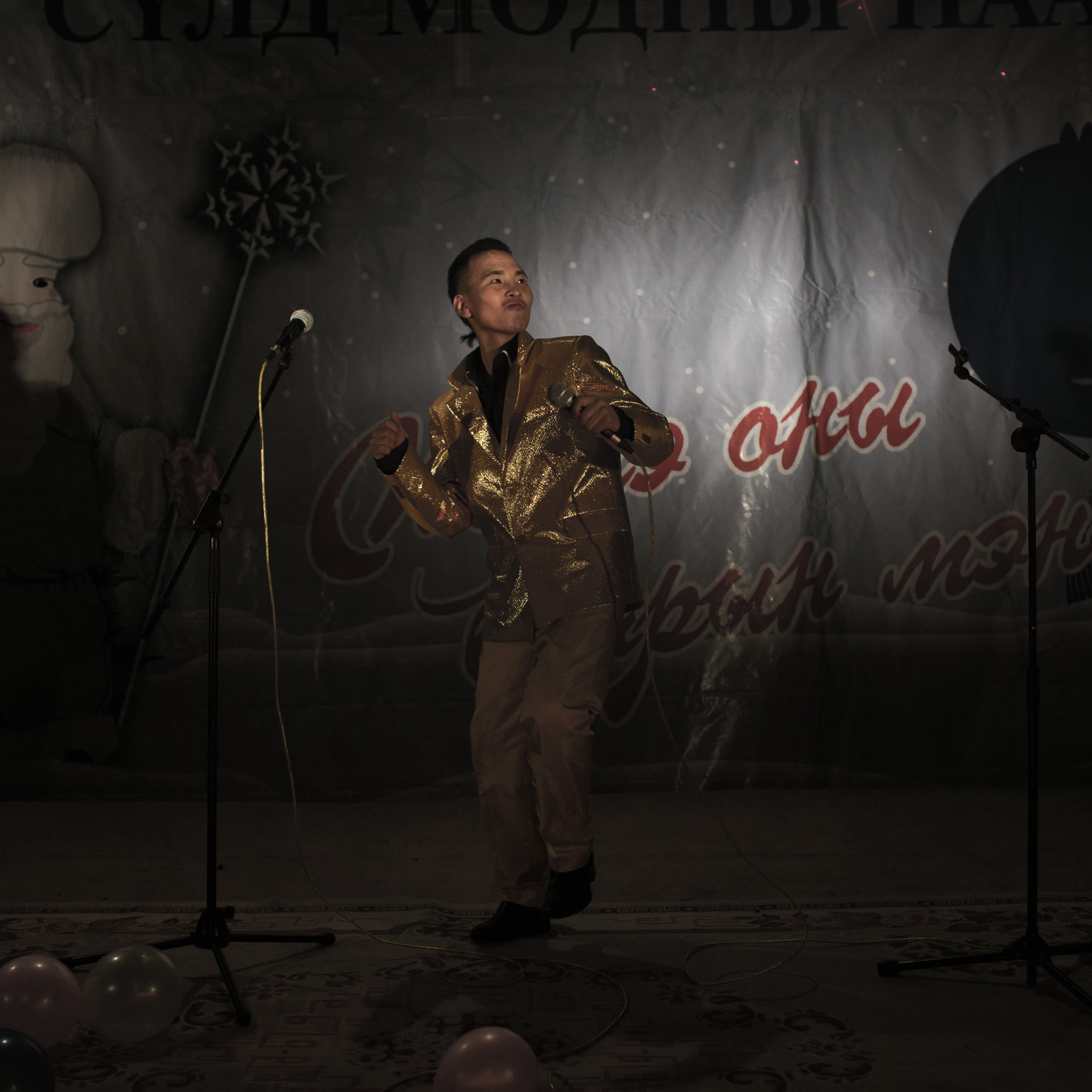 A Mongolian singer performs at a party organized by the Mobicom cellphone company. Mongolia, Gobi, Dalanzadgad, 2013.