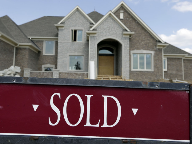 "A ""sold"" sign is posted outside a home in Carmel, Ind. Black and Latino homebuyers pay about 3.5 percent more for housing than whites and Asians, according to a study released this week by Duke University."