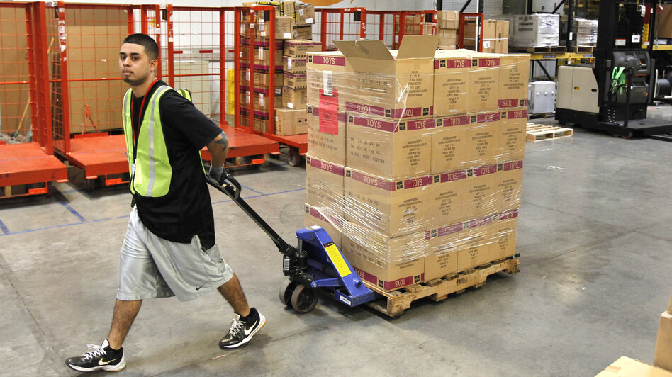 Humberto Manzano Jr. moves a pallet of goods at an Amazon.com fulfillment center in Phoenix in 2010. Amazon has endorsed a bill making its way through the Senate that would require more online retailers to collect sales tax. (AP)