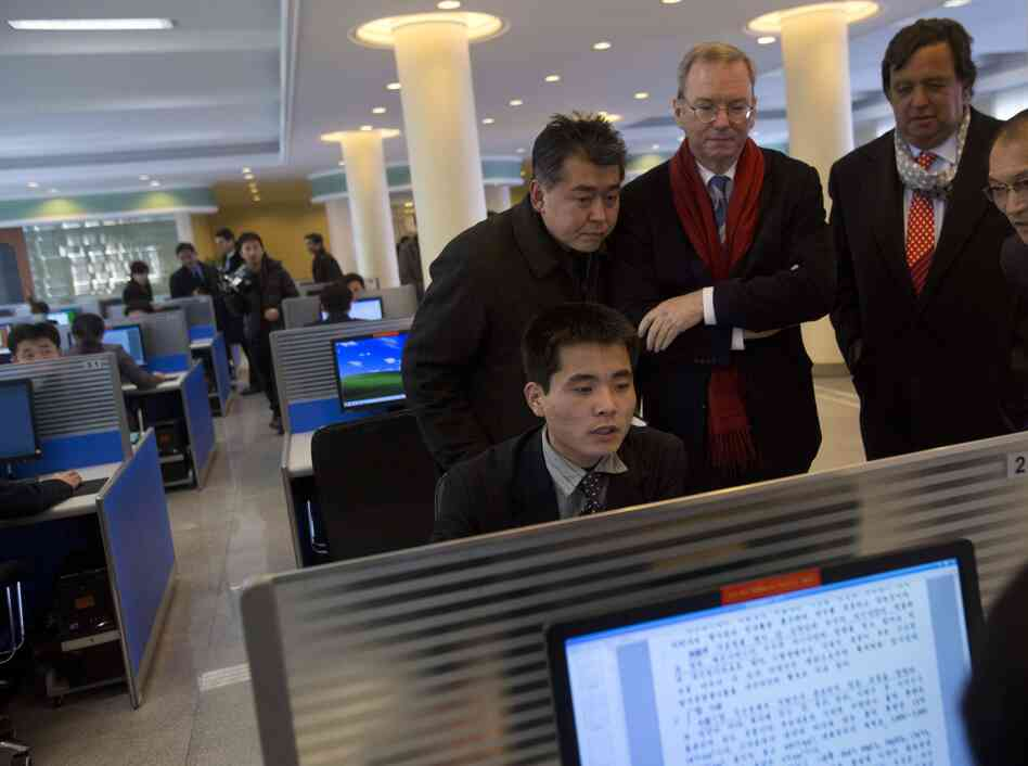 Eric Schmidt, the executive chairman of Google (third from left), and former New Mexico Gov. Bill Richardson (second from right) watch as a North Korean student surfs the Internet. Schmidt and Richardson visited this computer lab during a tour of Kim Il Sung University in Pyongyang, North Korea, in January.