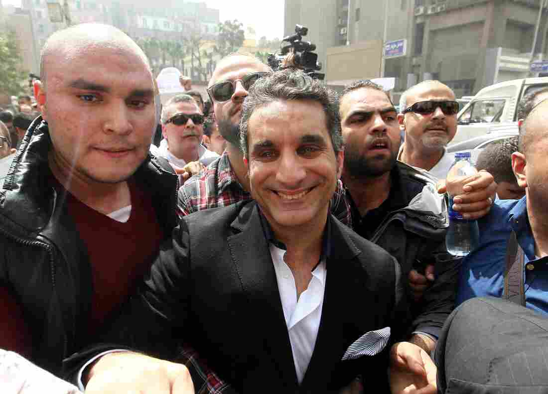 Egypt's popular TV satirist Bassem Youssef is surrounded by media and activists as he arrives at the high court in Cairo, Egypt, on March 31.