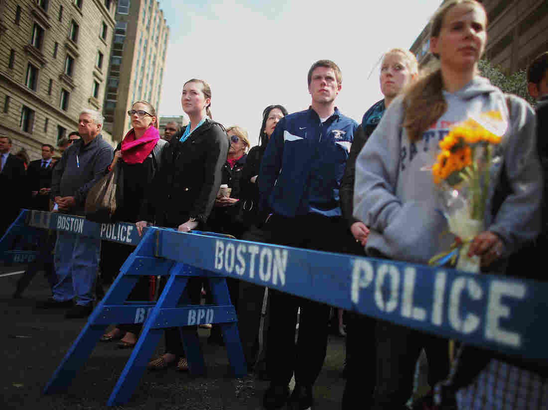 In Boston and other places across the nation, people gathered Monday for a moment of silence to honor the victims of the marathon bombing.
