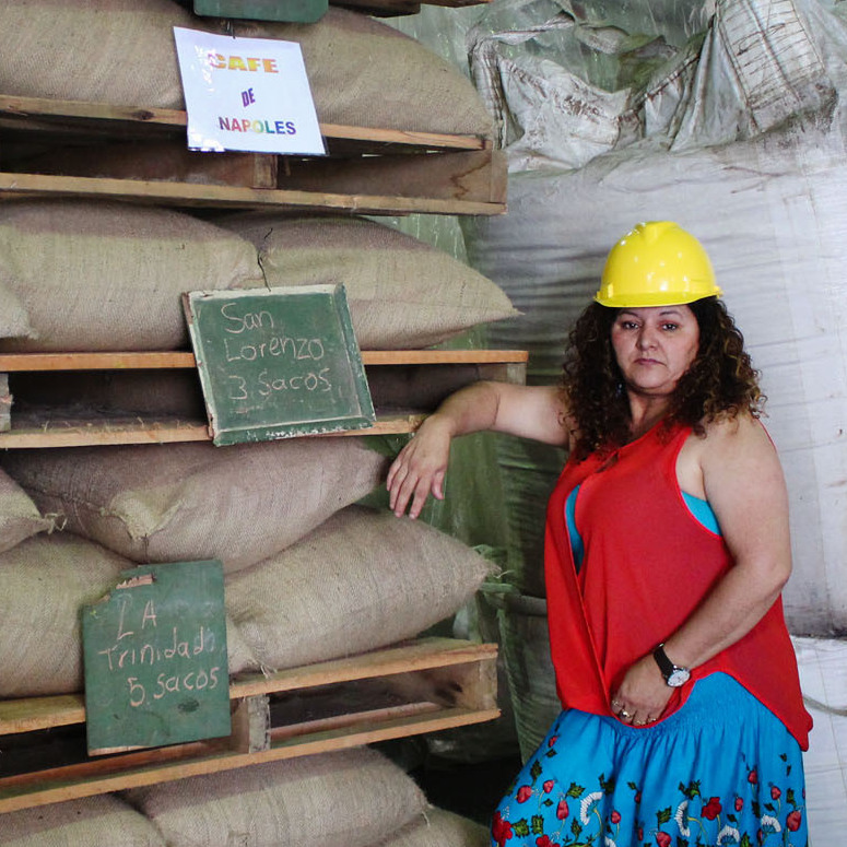 Angelina Zuñiga Godinez and Fanny Cordero Mora grow coffee for Coopetarrazu, one of Costa Rica's largest coffee cooperatives. These bags of coffee are labeled with the towns where they are grown