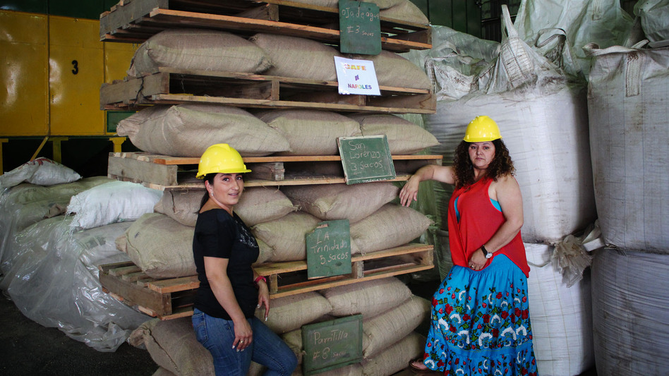 Angelina Zuñiga Godinez and Fanny Cordero Mora grow coffee for Coopetarrazu, one of Costa Rica's largest coffee cooperatives. These bags of coffee are labeled with the towns where they are grown (NPR)