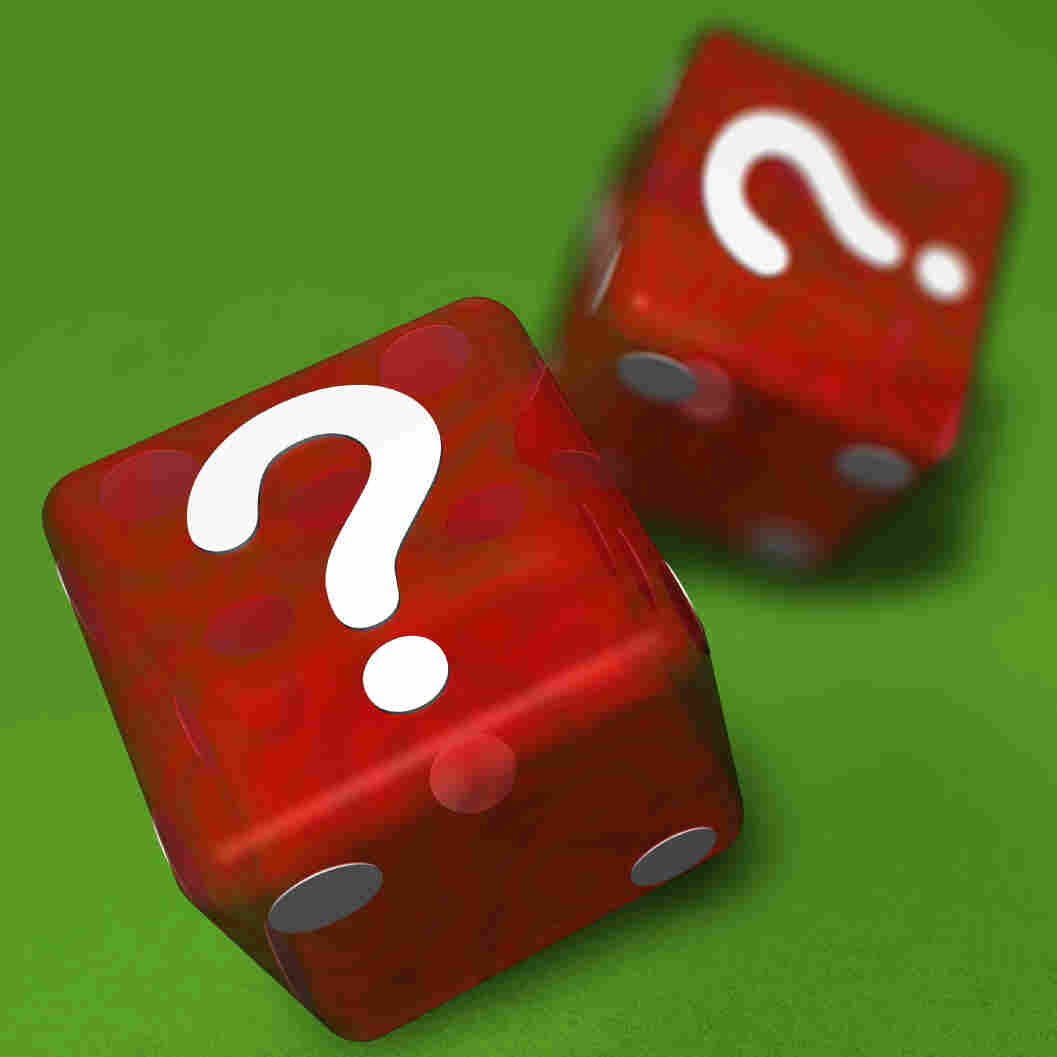 Two red casino dice landing question mark sided up on green cloth.