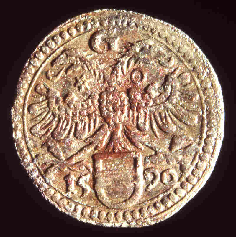 This 1590 copper token, issued at Groningen in the northern Netherlands, was found.