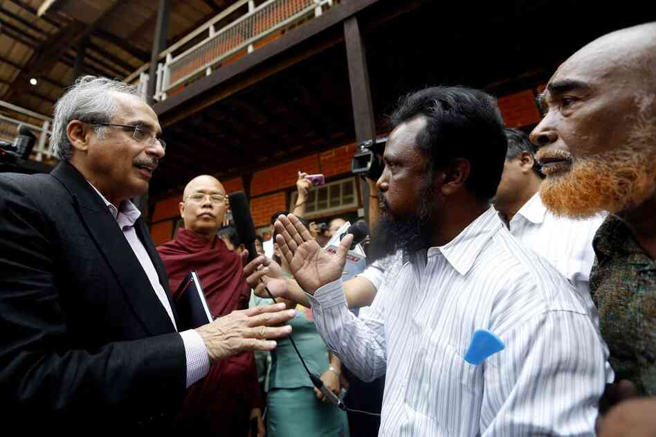 Vijay Nambiar (left), special adviser to the United Nations secretary-general, talks with a Muslim man at a temporary camp for displaced people in Meiktila in March.