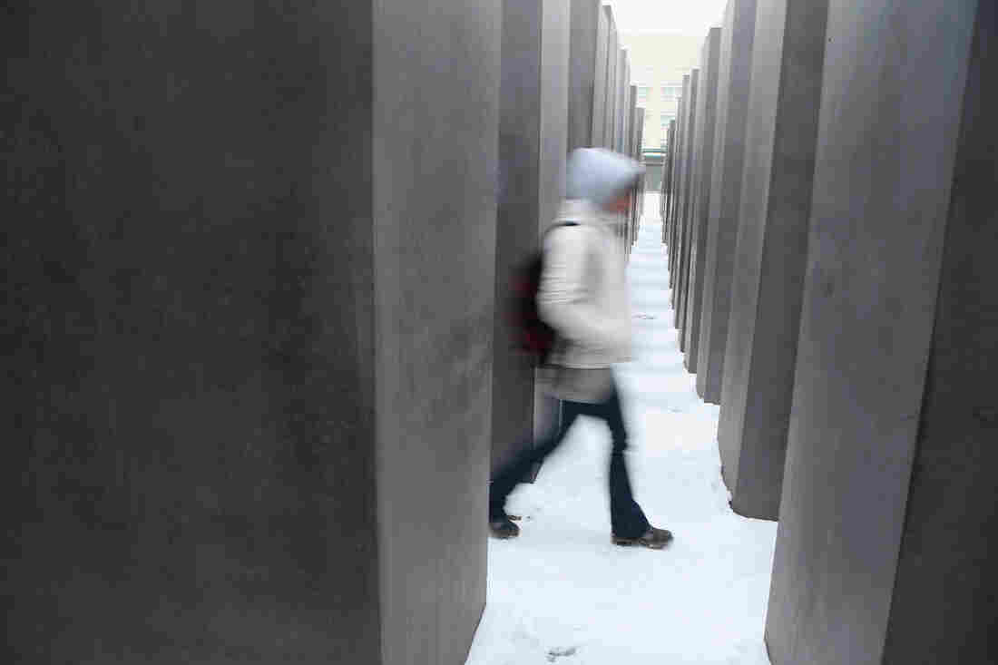 A visitor walks through the Memorial to the Murdered Jews of Europe, also known as the Holocaust Memorial, in Berlin, Germany.