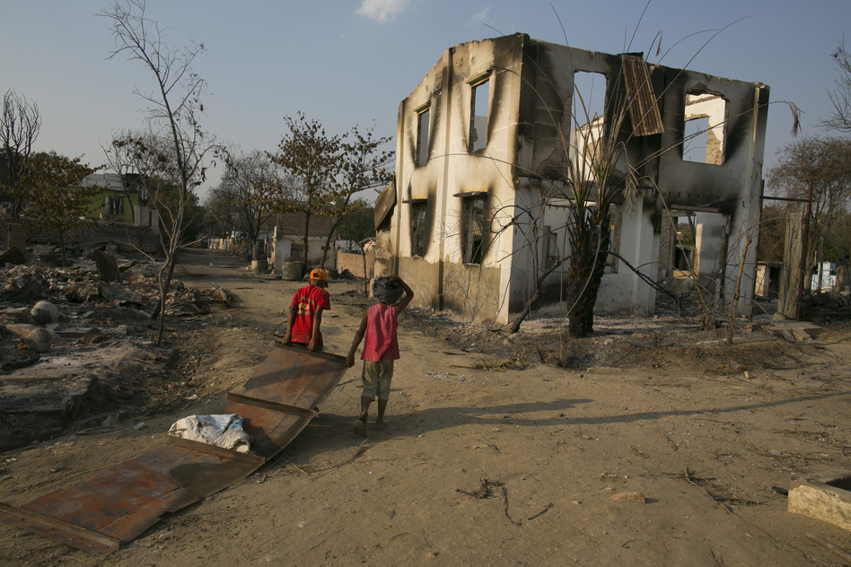 Myanmarese look for anything to salvage from the destruction in Meiktila. Local media reports say the violence began over a dispute involving a Buddhist couple who tried to sell a hairpin to the Muslim owners of a jewelry store. (Getty Images)