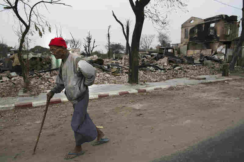 A man walks through town in April. While Myanmar's president, Thein Sein, declared a state of emergency during the riots, 1,500 homes had been destroyed by the time the violence stopped.