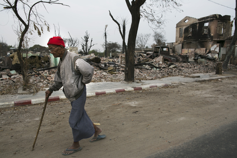 A man walks through town in April. While Myanmar's president, Thein Sein, declared a state of emergency during the riots, 1,500 homes had been destroyed by the time the violence stopped. (Getty Images)