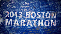 Signatures and messages adorn a Boston Marathon poster on Tuesday near the site of the April 15 bombings.