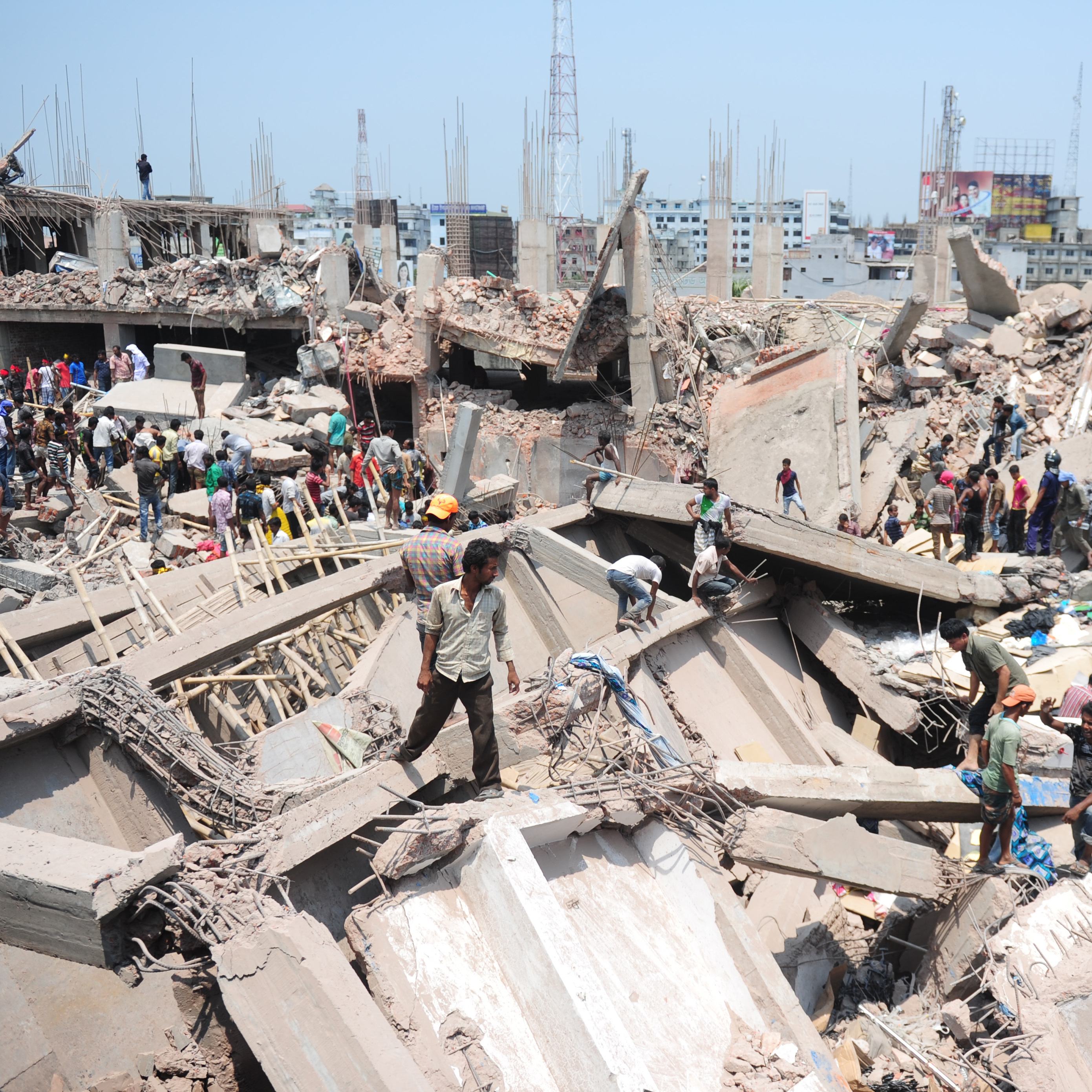 Volunteers assist in rescue operations after the building collapse in Savar, on the outskirts of Dhaka, on Wednesday.