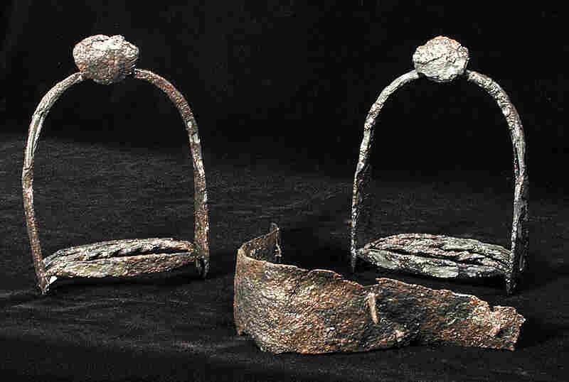 "Elements of a saddle, including the iron bracing and stirrups. This saddle, as well as many other elements of horse equipment, were thrown away after the horses were eaten during the ""starving time"" winter of 1609-1610."