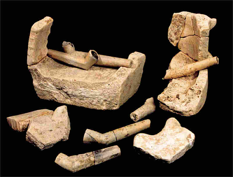 These distinctive tobacco pipes and fragments of a pottery-making device suggest that the 1608 colonist Robert Cotton made these. They were among the first commercial Jamestown products.