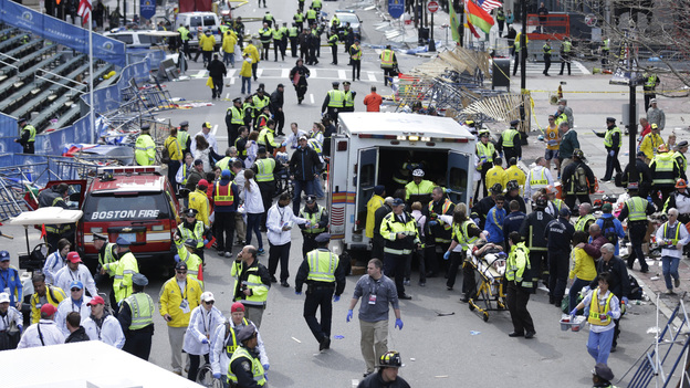 First responders aid injured people at the finish line of the Boston Marathon after the bombing on April 15. (AP)