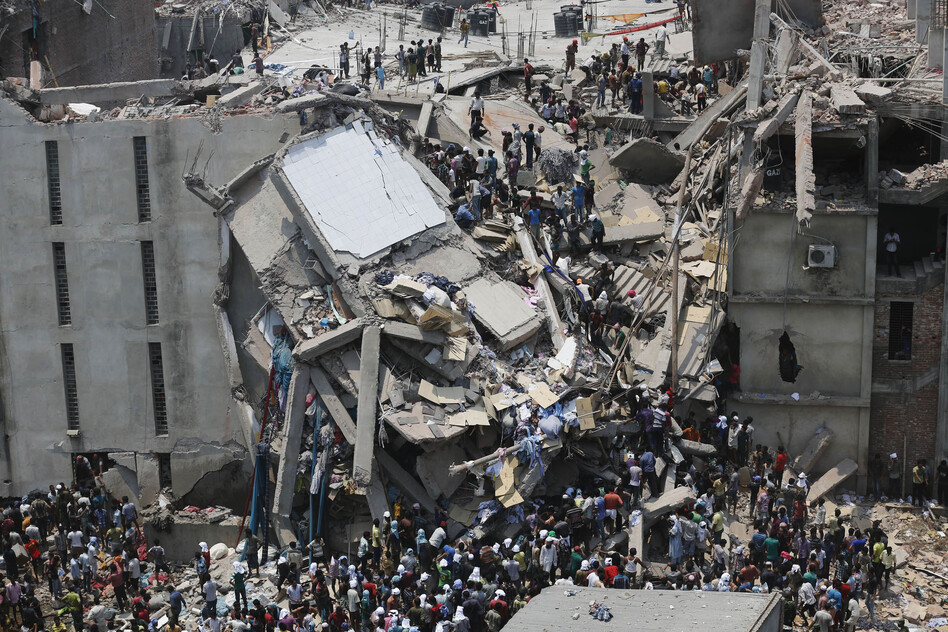 More than 70 people are dead and some 600 injured in the collapse of an eight-story building housing garment factories and a shopping center Wednesday in Bangladesh. (Reuters/Landov)