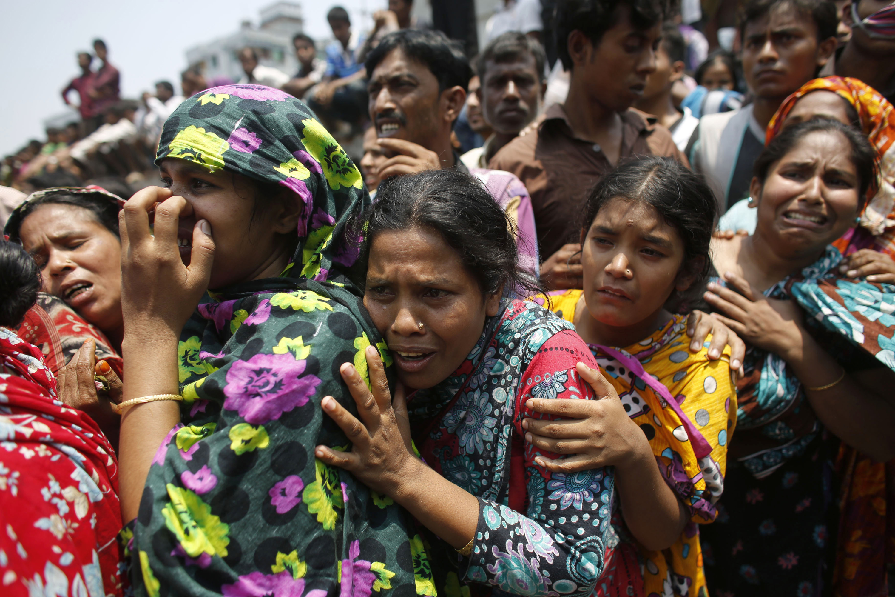 People mourn for relatives trapped inside the rubble of the collapsed Rana Plaza building.