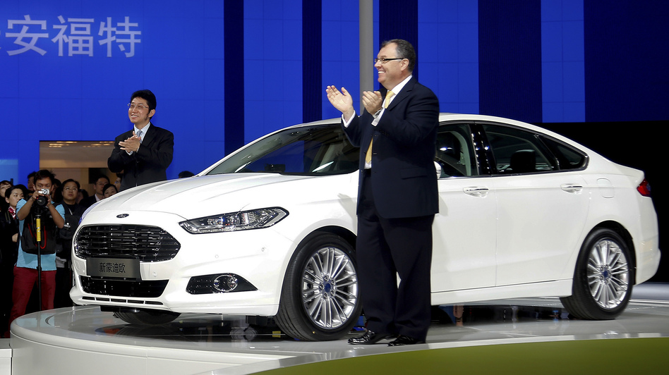 Chang'an Ford Mazda Automobile Co. Ltd. Executive Vice President Luo Minggang (left) and President Marin Burela unveil the new Ford Mondeo model at the Shanghai auto show this week. Ford's sales in China were up 30 percent last year. (AP)