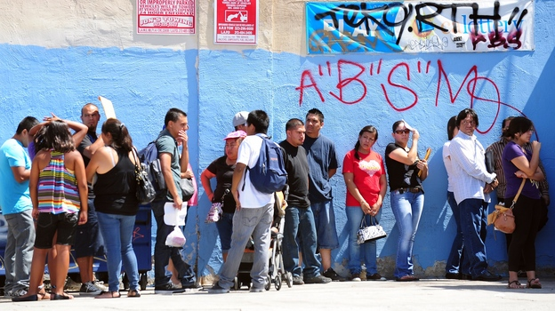 Young people wait in line to enter the Coalition for Humane Immigrant Rights of Los Angeles office on the first day of the Deferred Action for Childhood Arrivals program in August. (AFP/Getty Images)