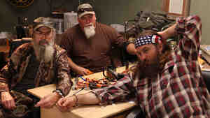 Some of the cast members of the reality show Duck Dynasty find themselves handcuffed to one another.