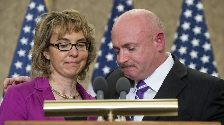 Former Arizona Rep. Gabrielle Giffords and her husband, Mark Kelly, at an April 16 ceremony naming a Capitol Hill conference room for her aide Gabe Zimmerman. Zimmerman died in the same Tucson, Ariz., shootings that Giffords wounded. (AFP/Getty Images)