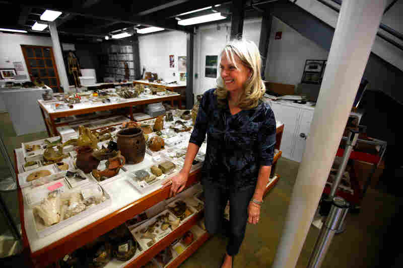 Bly Straub, the lead curator of the Jamestown artifacts, stands in a private storage and display room on Jamestown Island. Straub has traced the history of the artifacts to all parts of the world.