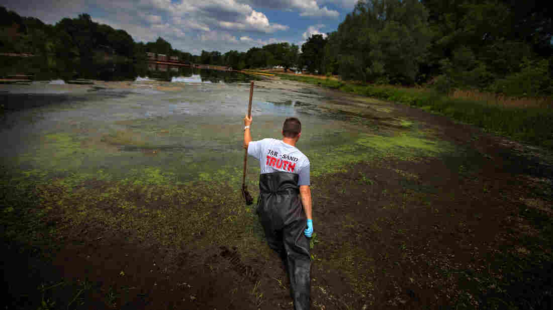 John Bolenbaugh wades through thick mud in the Kalamazoo River in August 2012, looking for leftover traces of oil from the July 2010 spill from the Enbridge oil sands pipeline.
