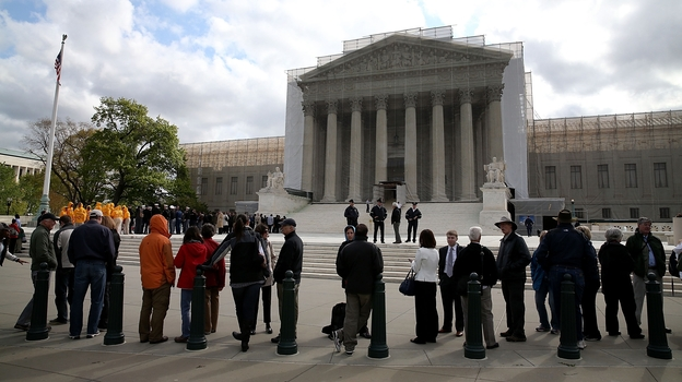 People line up to enter the U.S. Supreme Court on Tuesday. All of the court's archived audio, dating back to 1955, has now been digitized for public access online. (Getty Images)