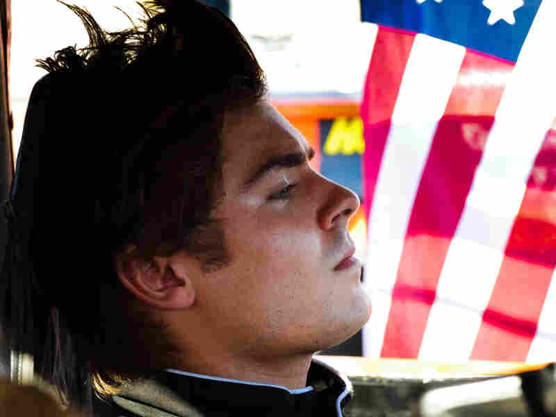 "In Ramin Bahrani's At Any Price, Zac Efron stars as a teen rebelling against his family and dreaming of becoming a professional race car driver. Sound like a generic summer pic? Critic David Edelstein says the film has ""a hell of a sting in its tail."""