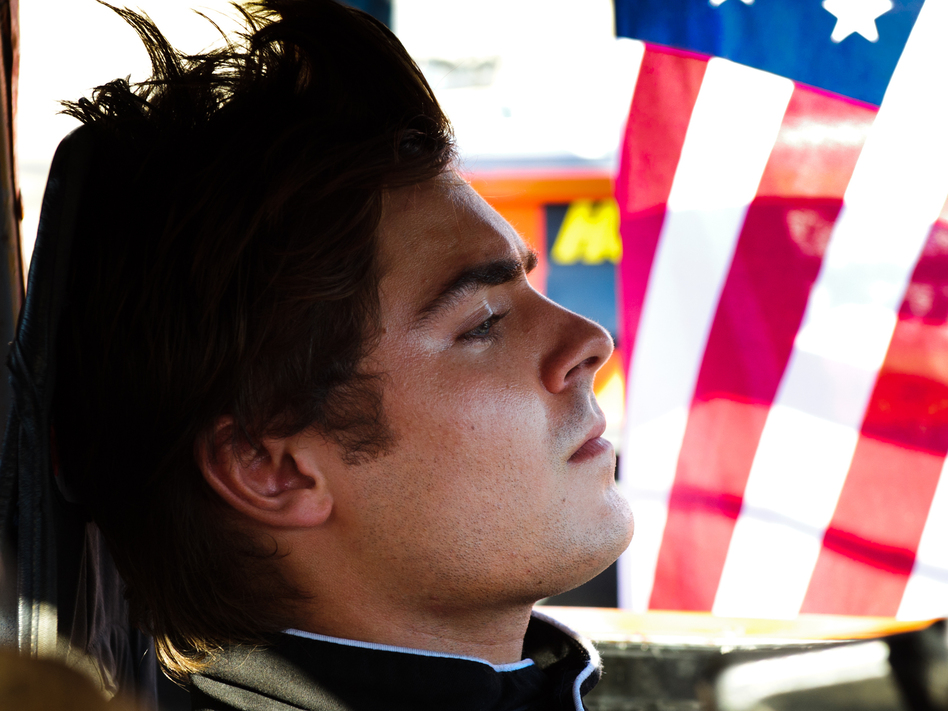 "In Ramin Bahrani's <em>At Any Price, </em>Zac Efron stars as a teen rebelling against his family and dreaming of becoming a professional race car driver. Sound like a generic summer pic? Critic David Edelstein says the film has ""a hell of a sting in its tail."""