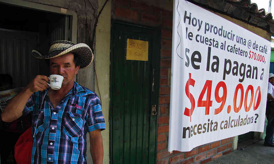 A Colombian farmer sips cofee during a national coffee producers' strike Feb. 25 in Colombia. Thousands of coffee farmers rallied and marched throughout Colombia in protest the economic difficulties of th
