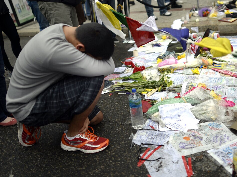 Visitors paid their respects at a makeshift memorial on Boylston Street on April 20, near the scene of the Boston Marathon bombings. (Timothy A. Clary/AFP/Getty Images)