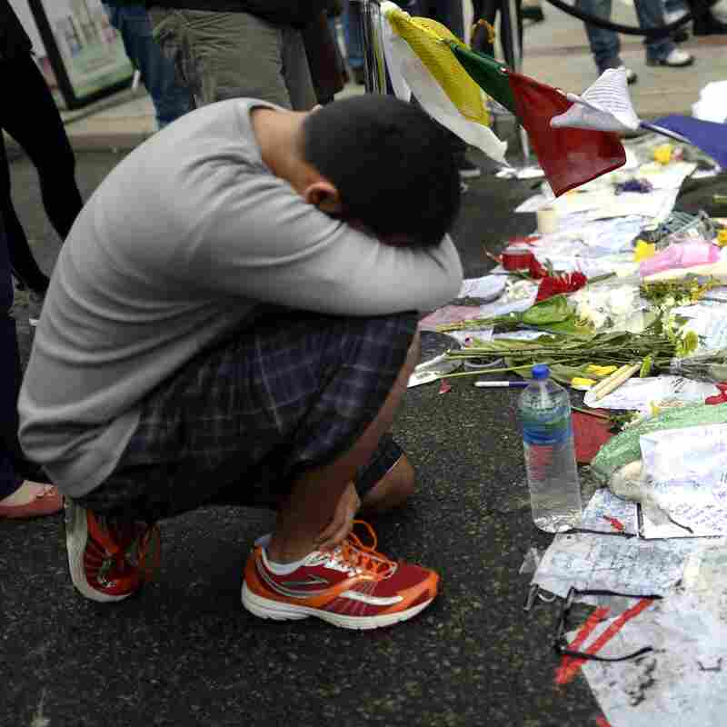Visitors paid their respects at a makeshift memorial on Boylston Street on April 20, near the scene of the Boston Marathon bombings.