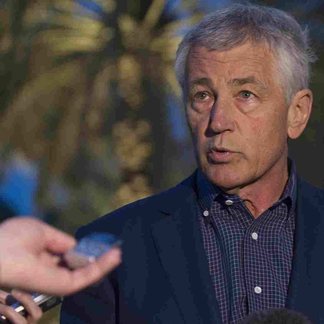 Secretary of Defense Chuck Hagel speaks with reporters on Thursday in the United Arab Emirates after reading a statement on chemical weapon use.
