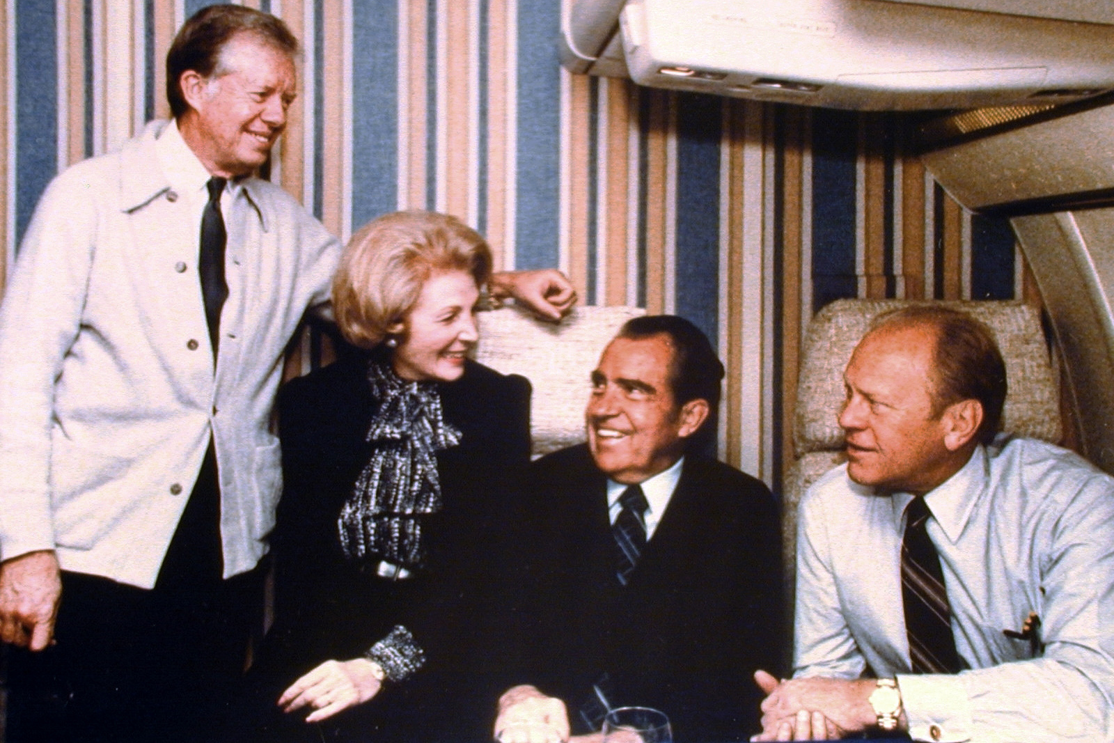 This Oct. 10, 1981 photo released by the Annenberg Foundation Trust at Sunnylands, shows former presidents Jimmy Carter, left,, Richard Nixon, center right, and Gerald Ford with then U.S. Chief of Protocol Leonore Annenberg aboard an Air Force jet carrying them to the funeral of Anwar al-Sadat.