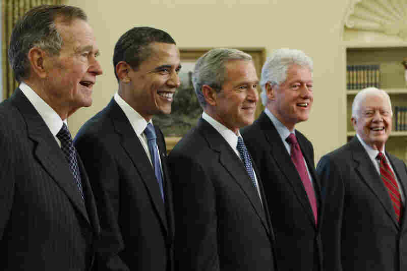 President George W. Bush, center, with President-elect Barack Obama, and former presidents, from left, George H.W. Bush, left, Bill Clinton and Jimmy Carter, right, Wednesday, Jan. 7, 2009, in the Oval Office of the White House in Washington.