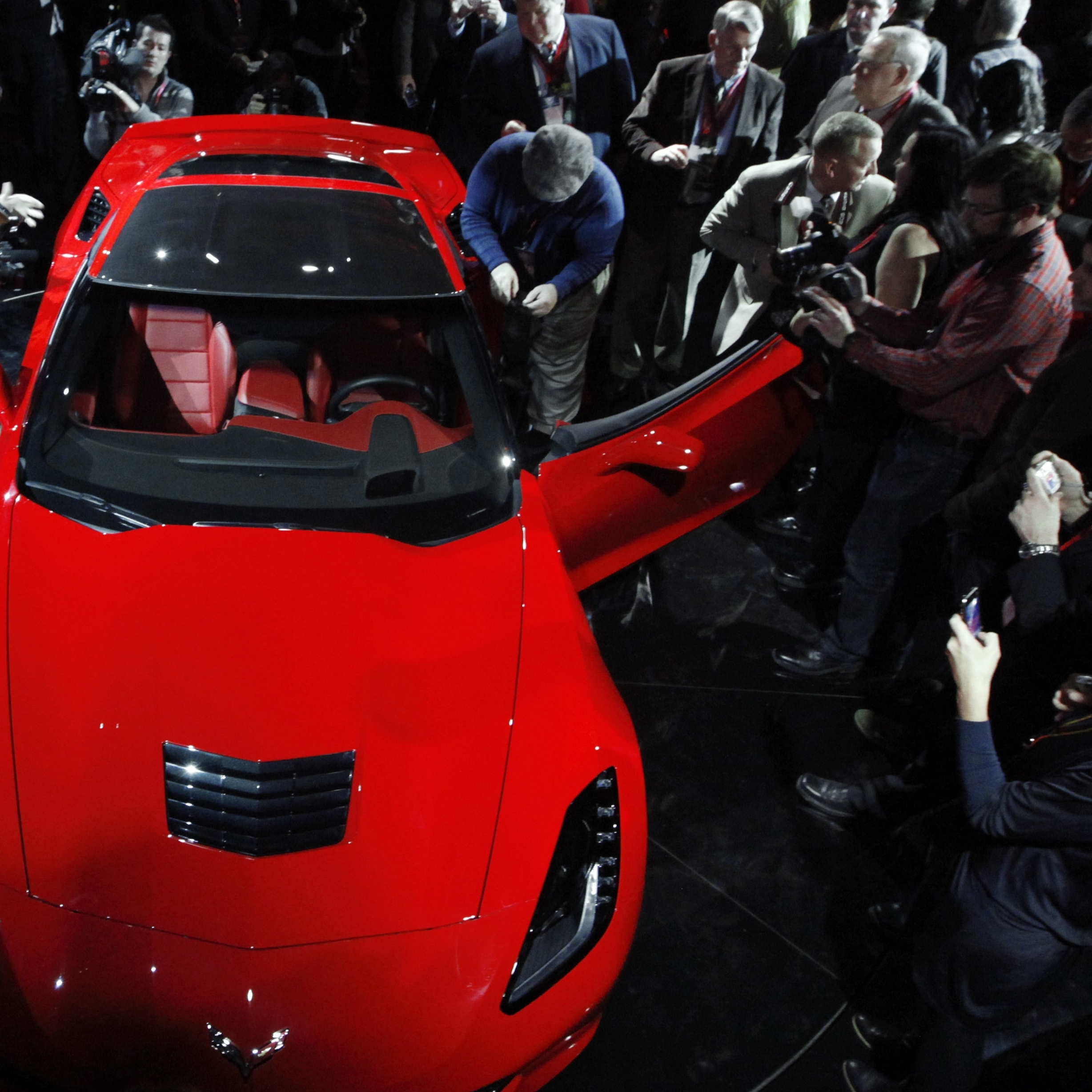 In this photo from this year's Detroit auto show, journalists surround General Motors' new 2014 Chevrolet Corvette Stingray.