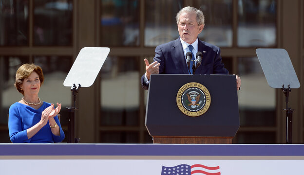 Former President George W. Bush speaks alongside former first lady Laura Bush during the opening ceremony of the George W. Bush Presidential Library and Museum on Thursday in Dallas.