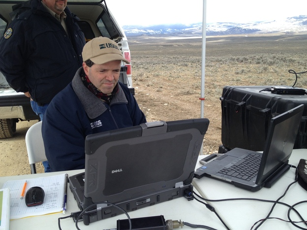 USGS mission operator Jeff Sloan monitors the Raven A's progress. Each flight requires a three-person team that includes a mission operator, observer and pilot.