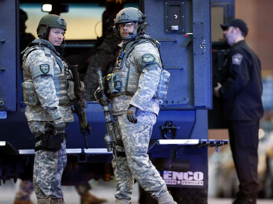 SWAT team members stand guard on the campus of Massachusetts General Hospital following the explosions at the finish line of the Boston Marathon. (Michael Dwyer/AP)