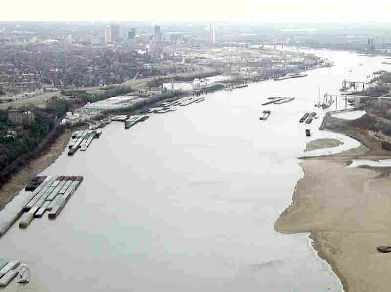 Sandbars are exposed while barges are forced to park along the shores of the Mississippi River south of St. Louis last year.