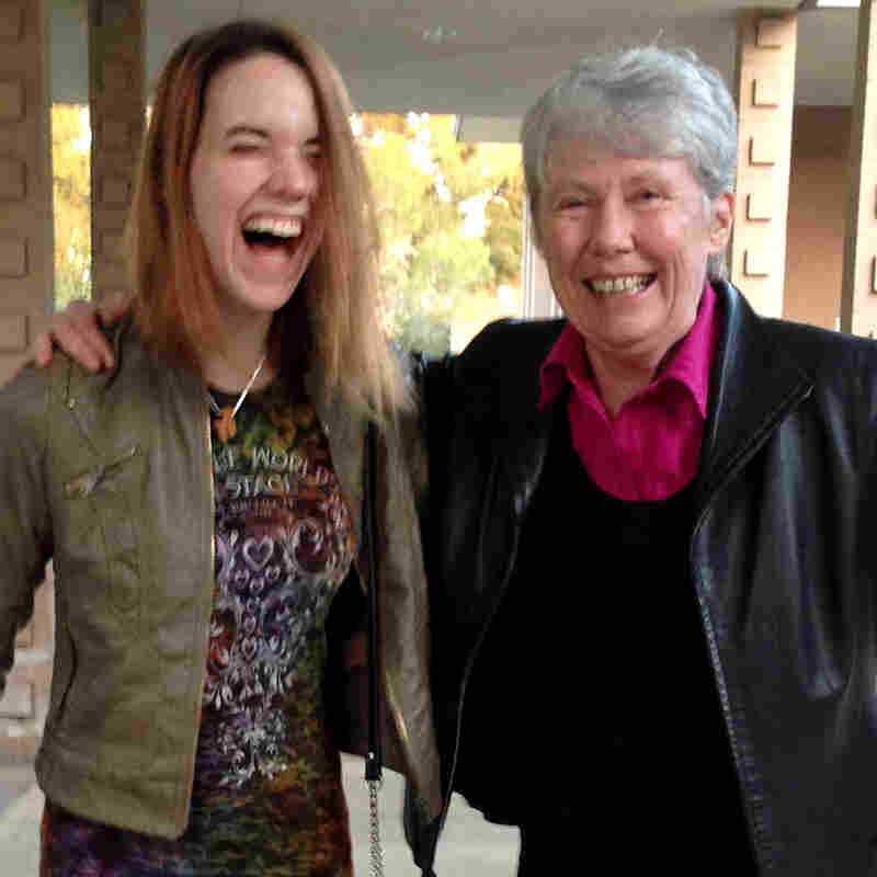 Harvey Mudd President Maria Klawe often uses her longboard to get around campus and chat with students like senior Xanda Schofield.