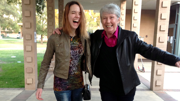 Harvey Mudd President Maria Klawe often uses her longboard to get around campus and chat with students like senior Xanda Schofield. (NPR)