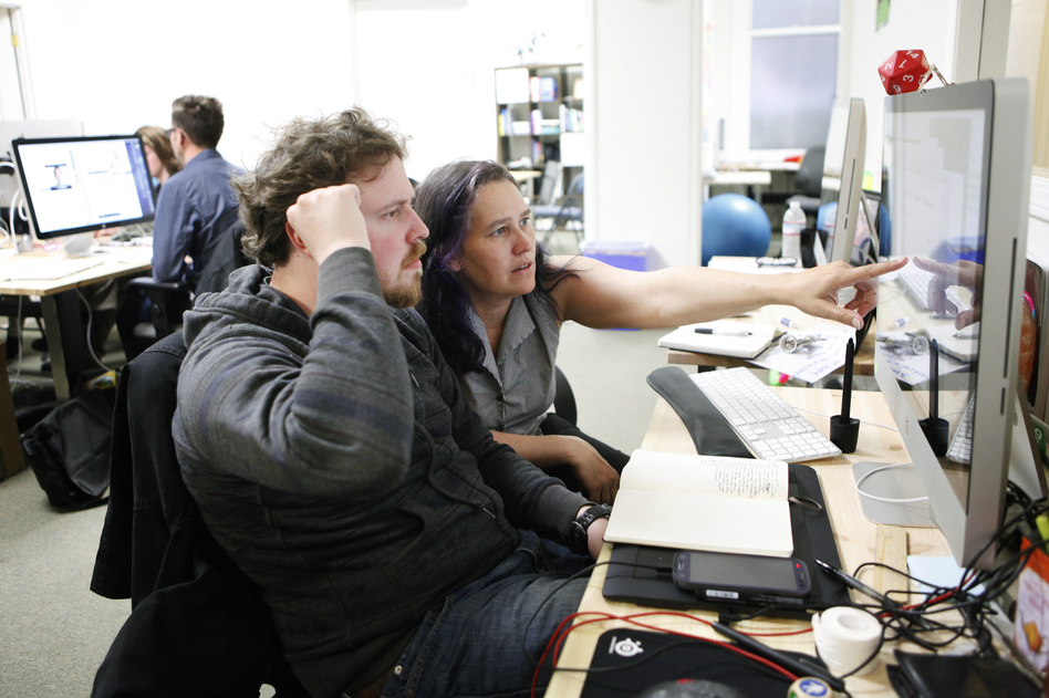 Sarah Allen, CEO of Blazing Cloud, works with user experience designer Anton Zadorozhnyy in the company's offices in San Francisco. (Ramin Rahimian for NPR)