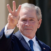 "Former President George W. Bush shows three fingers for ""W"" with his wife, former First Lady Laura Bush, at the opening ceremony of the George W. Bush Presidential Center in Dallas on Thursday."
