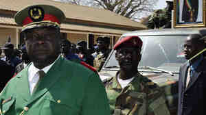 Gen. Antonio Indjai (left), Guinea-Bissau's army chief of staff, at the funeral of the country's late president, Malam Bacai Sanha, on Jan. 15, 2012. The U.S. says Indjai has been involved in drug trafficking, an allegation he denies. He recently eluded a U.S. sting operation that led to the capture of other officials from his country.
