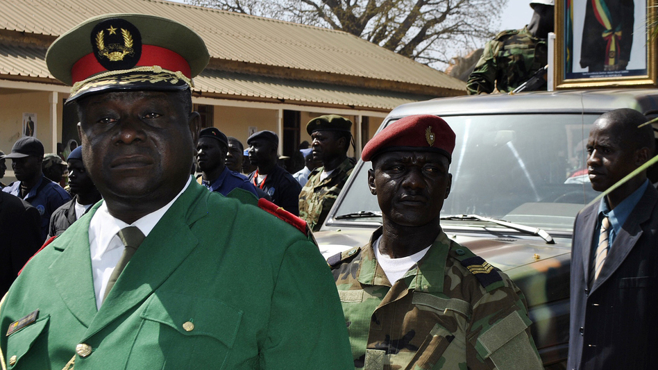 Gen. Antonio Indjai (left), Guinea-Bissau's army chief of staff, at the funeral of the country's late president, Malam Bacai Sanha, on Jan. 15, 2012. The U.S. says Indjai has been involved in drug trafficking, an allegation he denies. He recently eluded a U.S. sting operation that led to the capture of other officials from his country. (AFP/Getty Images)